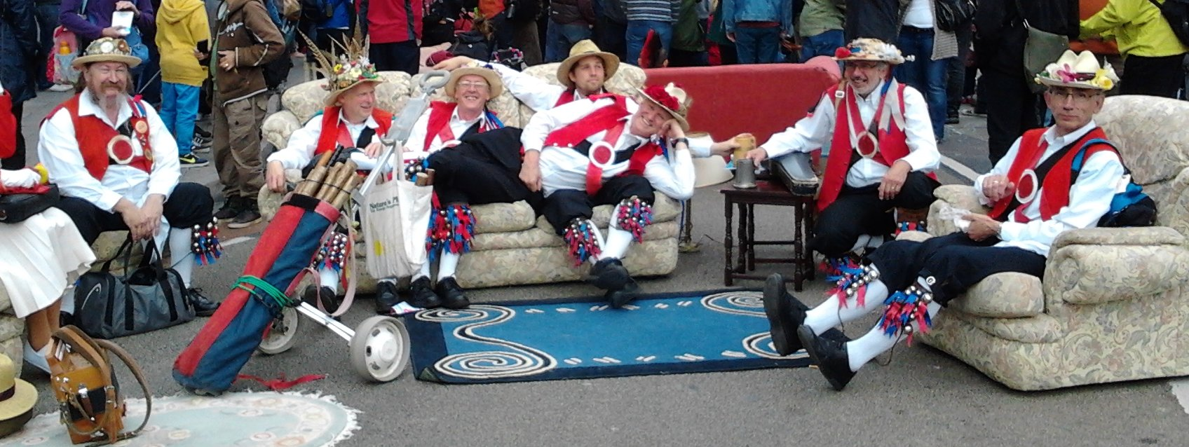 Bristol Morris Men sitting on a sofa